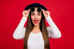 Portrait of astonished fancy dreamy lady in blue velvet retro hat look incredible bargain cant believe touch specs scream wow omg wear white sweater isolated over bright shine color background