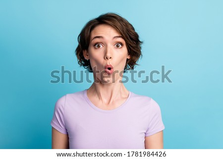 Portrait of astonished girl hear unbelievable novelty impressed stare stupor wear casual style outfit isolated over blue color background Foto d'archivio ©