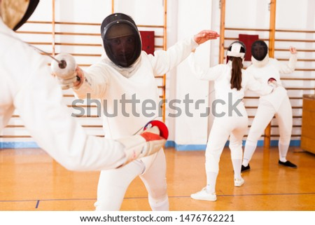 Portrait of athletes at fencing workout, practicing attack movements in duel  #1476762221
