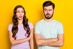 Portrait of attractive annoyed mad couple having fight misunderstanding isolated over bright yellow color background
