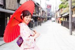 portrait of attractive asian woman wearing kimono
