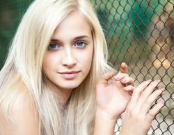 Portrait of attractive beautiful blonde girl with blue eyes