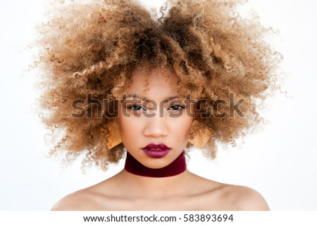 Portrait of attractive black model with natural curly hair. Close up portrait of young beautiful afro-american woman with bright lipstick, fashion make-up. #583893694