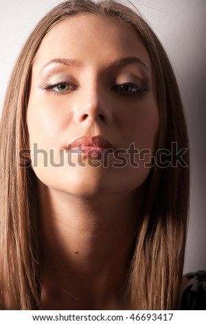 Portrait of attractive brown-haired girl with make-up - stock photo