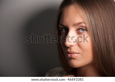 Portrait of attractive brunette girl with shadows and copyspace
