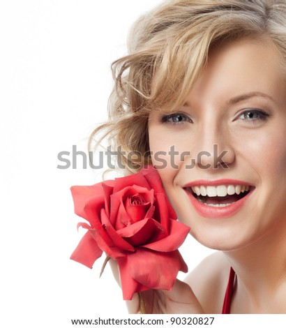 portrait of attractive  caucasian smiling woman blond isolated on white studio shot in red dress with rose