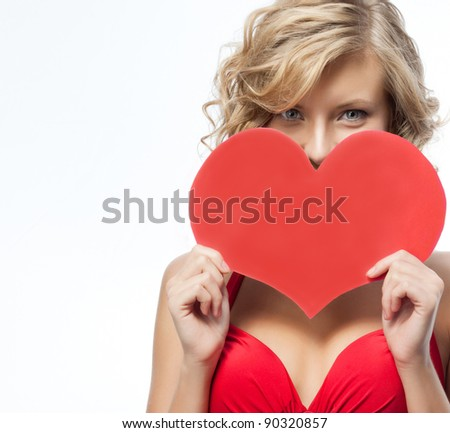 portrait of attractive  caucasian smiling woman blond isolated on white studio shot in red dress with heart