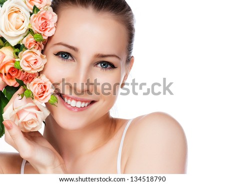portrait of attractive caucasian smiling woman blond with roses isolated on white studio shot
