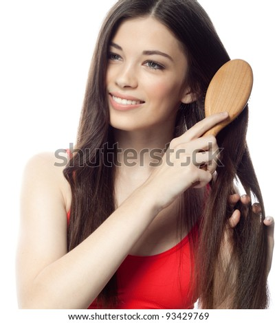portrait of attractive  caucasian smiling woman brunette brushing her hair isolated on white studio shot