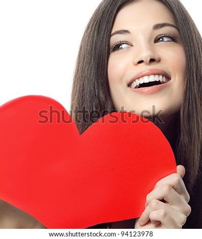 portrait of attractive  caucasian smiling woman brunette isolated on white studio shot with heart