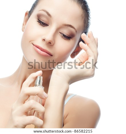 portrait of attractive  caucasian smiling woman isolated on white studio shot applying parfum
