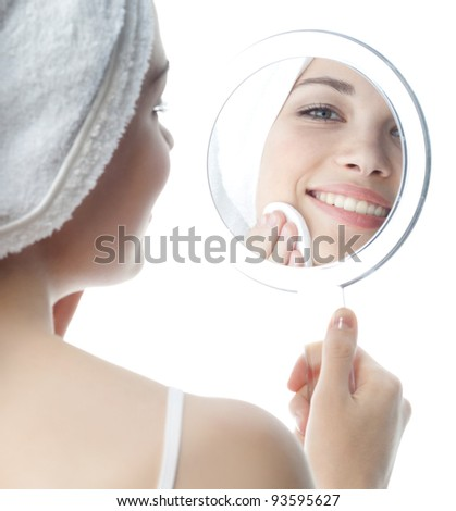 portrait of attractive  caucasian smiling woman isolated on white studio shot cleaning her face