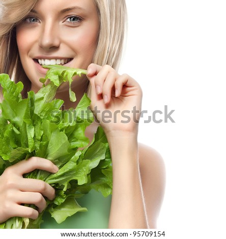 portrait of attractive  caucasian smiling woman isolated on white studio shot eating salat #95709154
