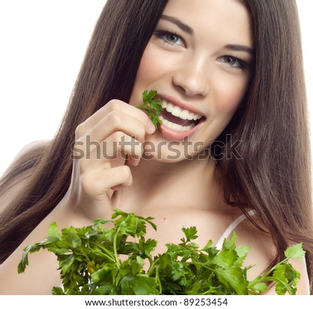 portrait of attractive  caucasian smiling woman isolated on white studio shot eating salat parsley #89253454