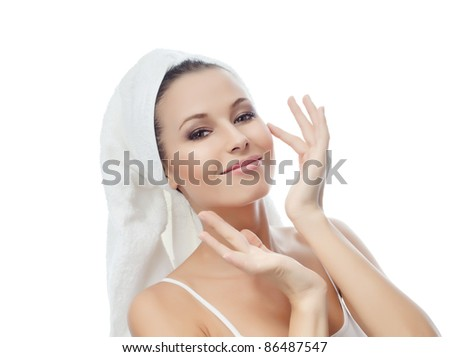 portrait of attractive  caucasian smiling woman isolated on white studio shot towel on head looking at camera