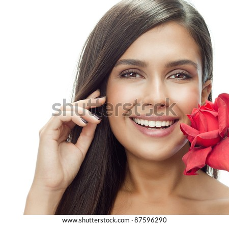 portrait of attractive  caucasian smiling woman isolated on white studio shot with red rose looking at camera