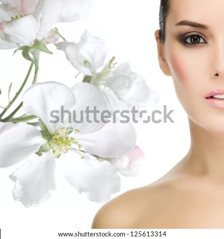 portrait of attractive  caucasian  woman brunette isolated on white studio shot face closeup eyes flowers