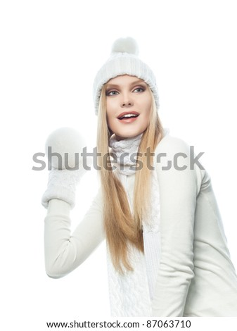 portrait of attractive  caucasian woman  with long blond hair in warm clothing isolated on white studio shot with snowball