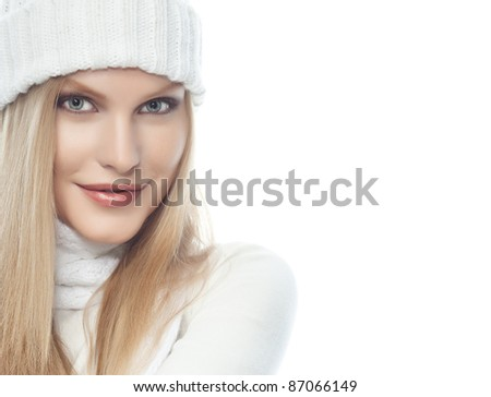 portrait of attractive  caucasian woman  with long blond hair in warm clothing  isolated on white studio shot looking at camera