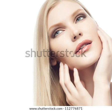 portrait of attractive  caucasian woman  with long blond hair isolated on white studio shot hands near face