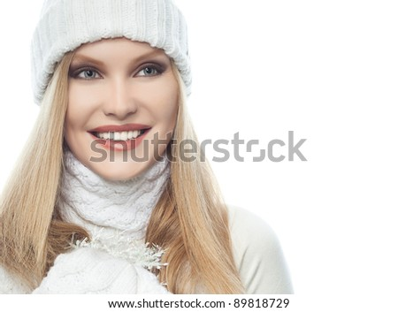 portrait of attractive  caucasian woman  with long blond hair th warm clothing isolated on white studio shot
