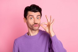 Portrait of attractive cheerful funny guy pretending like smoking cigarette isolated over pink pastel color background