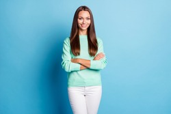 Portrait of attractive content cheerful cheery girl folded arms wearing casual isolated over bright blue color background