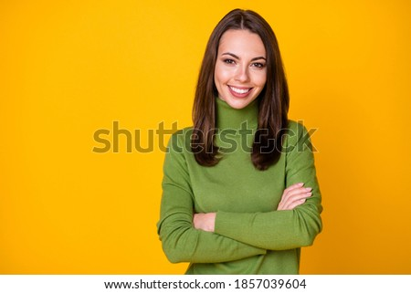 Portrait of attractive content cheerful girl folded arms wearing cosy sweater isolated over bright yellow color background Stockfoto ©