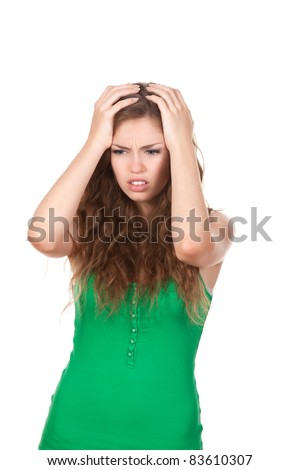 portrait of attractive depressed teenage girl hold hands on head, green shirt, brown long hair, isolated over white background concept of sad young pretty woman, problem worried hopeless student