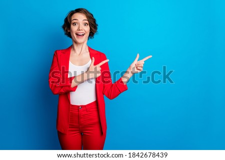 Portrait of attractive excited amazed cheerful lady demonstrating copy space offer black friday isolated on bright blue color background Foto stock ©