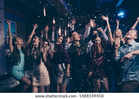 Portrait of attractive fellow buddies fellowship move motion laugh laughter dressed formal wear dress suit raise hands arms discotheque scream loud place