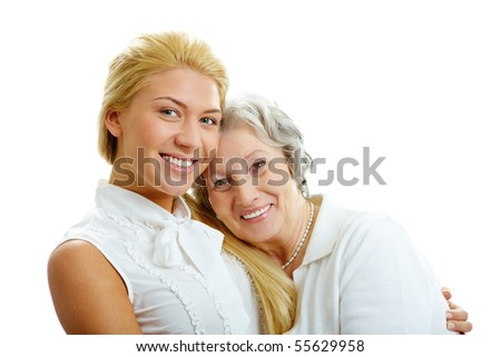 Portrait of attractive girl and senior woman embracing each other