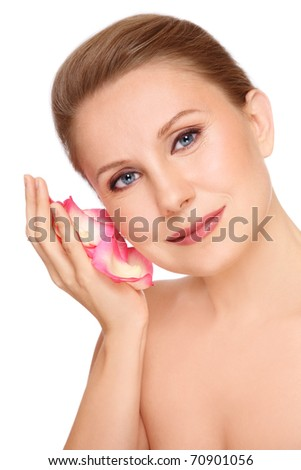 Portrait of attractive groomed healthy middle-aged woman with rose petals in her palm, on white background