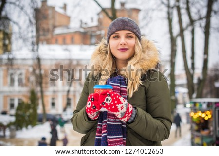 93b43dae6c207 Portrait of attractive happy plus size young model in parka jacket casual  style walk at city