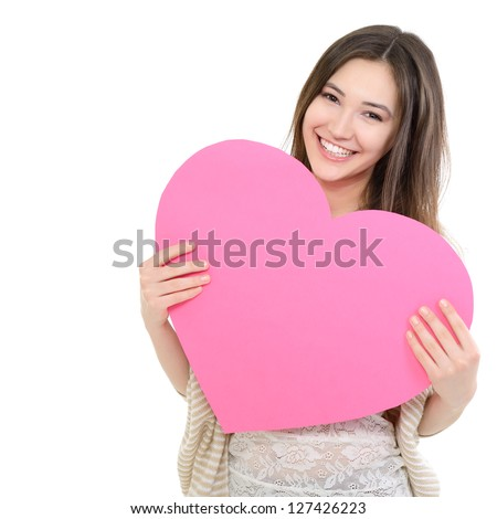 portrait of attractive happy smiling teen girl with pink heart love holiday valentine symbol over white background