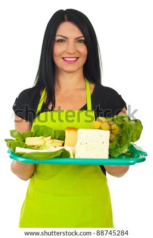 Portrait of attractive market worker female serving  different cheese on plateau isolated on white background