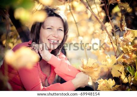 Portrait of attractive mature woman outdoor