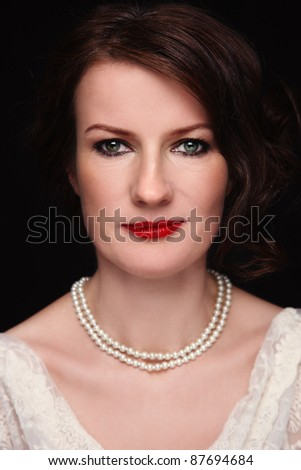 Portrait of attractive middle-aged woman in vintage dress, selective focus