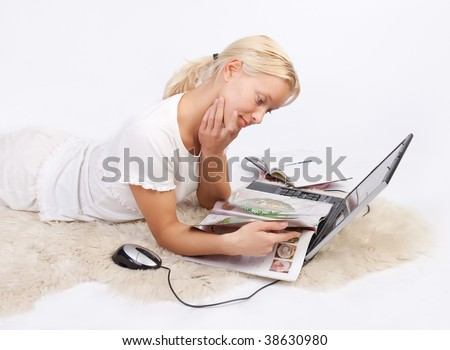 Portrait of attractive pensive girl resting and reading magazine