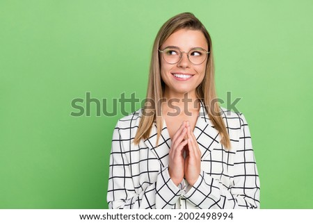 Portrait of attractive sly cheery classy lady expert thinking looking aside copy empty space isolated over green color background Stock fotó ©