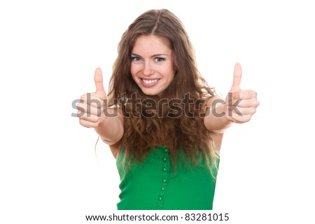 portrait of attractive smile teenage girl show thumbs up gesture, in green shirt, with white teeth, brown long hair, isolated over white background concept of success happy student, young pretty woman