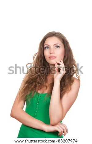 portrait of attractive teenage girl think looking up, wear green shirt, brown long hair, isolated over white background concept of pondering thoughtful student, young pretty woman