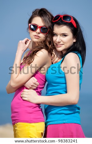 Portrait of attractive teenage girls enjoying at the beach