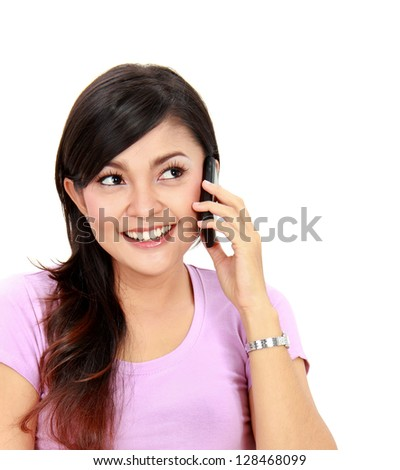 Portrait of attractive teenager talking on her mobile phone