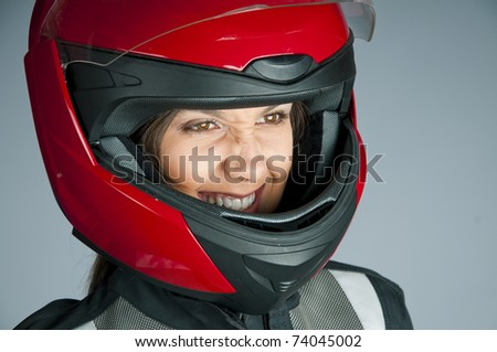 Portrait of attractive woman in motorbike helmet looking aside