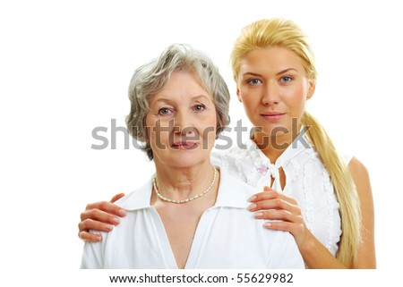 Portrait of attractive woman touching her old mother - stock photo