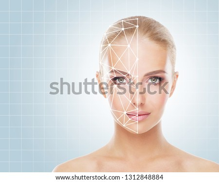 Portrait of attractive woman with a scnanning grid on her face. Face id, security, facial recognition concept.