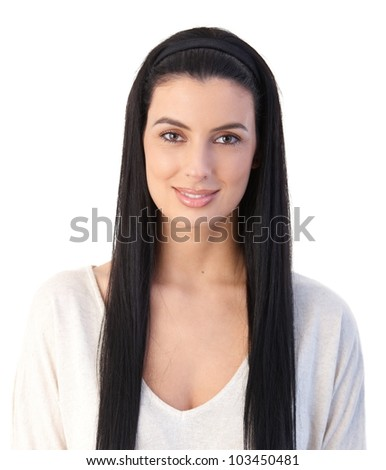 Portrait of attractive woman with long black hair, smiling at camera.