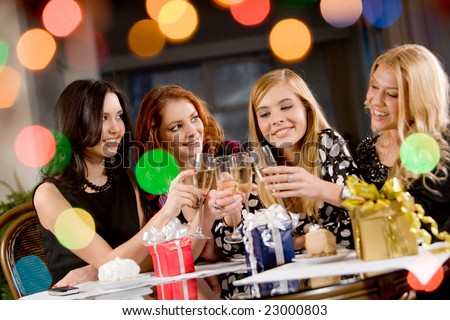 Portrait of attractive women clinking champagnes with each other during hen-party