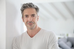 Portrait of attractive 50-year-old man